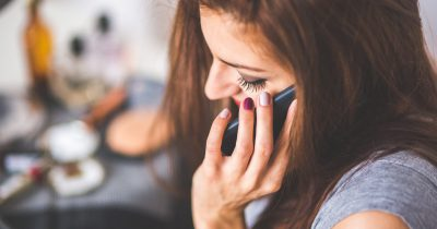 closeup-portrait-of-young-lady-talking-on-mobile-phone-6386